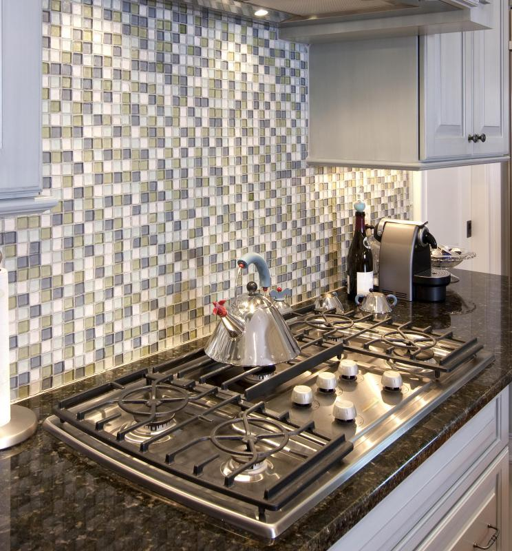 A shiny, tile backsplash works better in a modern kitchen than in a rustic one.