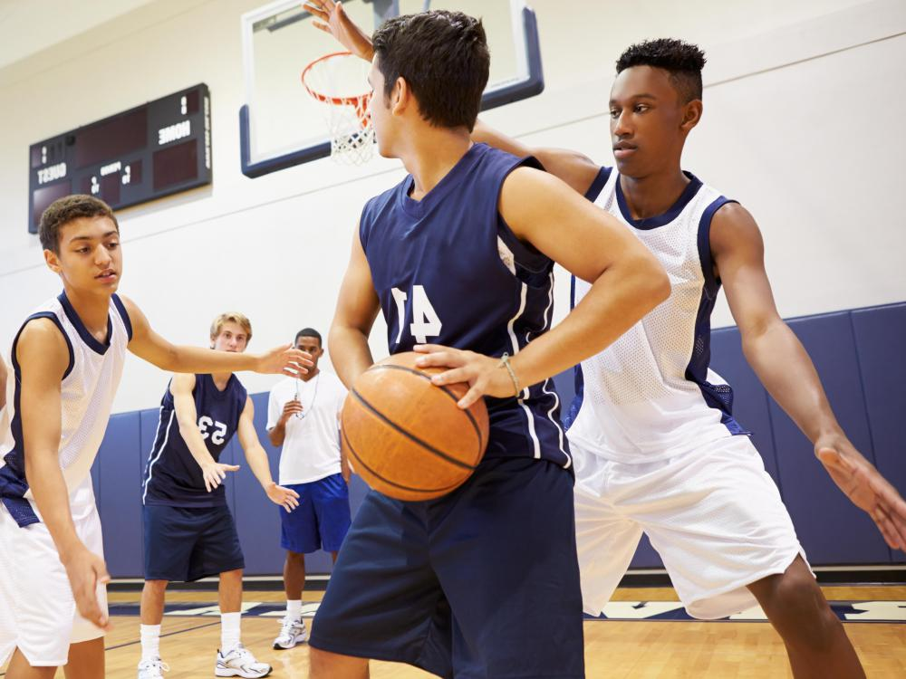 Sports programs geared toward at-risk youth are an example of community development projects.