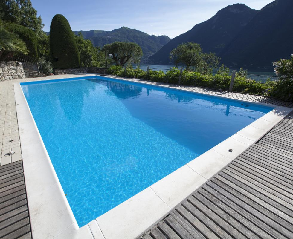 A small amount of hydrochloric acid may be used to lower a pools pH.