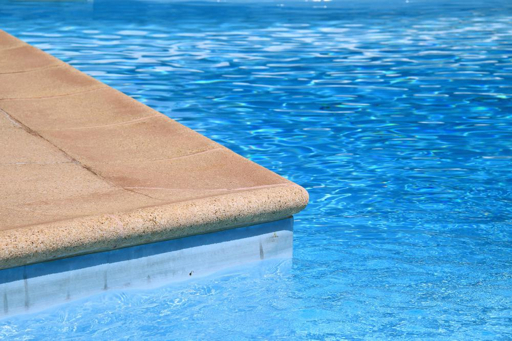 The water in swimming pools are treated with chlorine, which acts as a disinfectant.