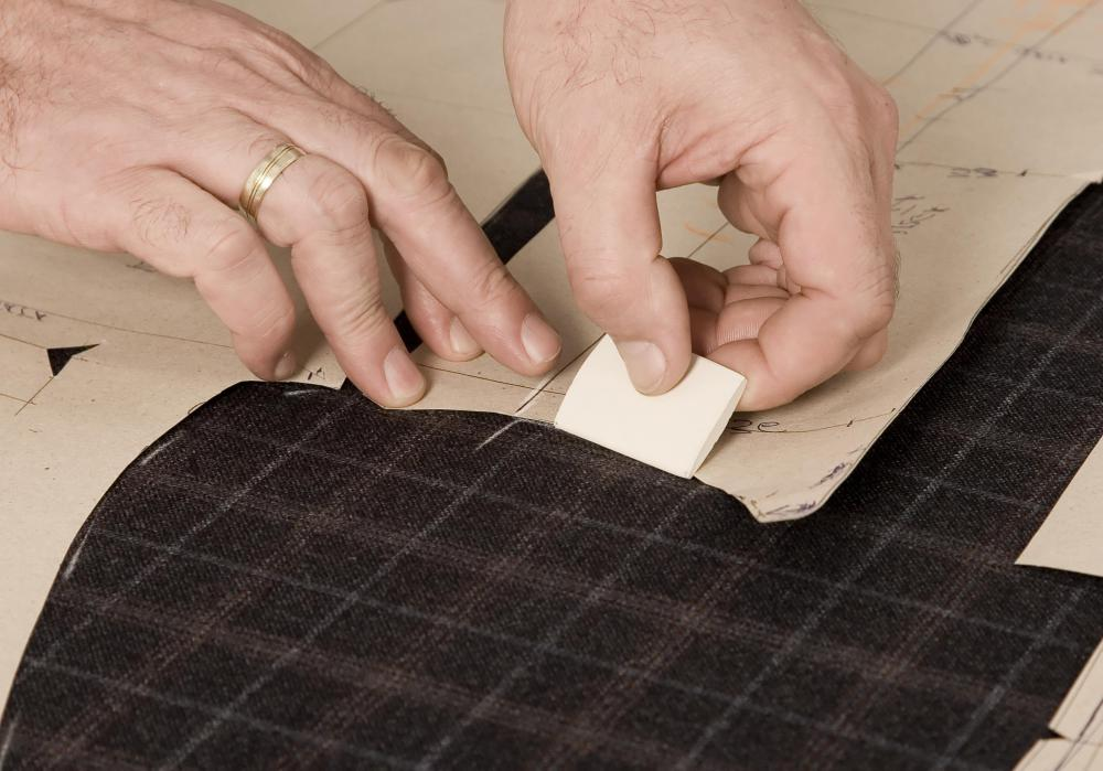 Tailors use chalk to temporarily mark fabric for cutting or altering.