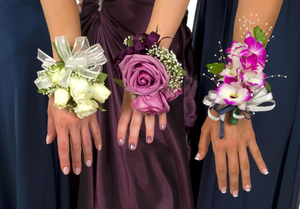 A high school girl may receive a wrist corsage on her prom night.