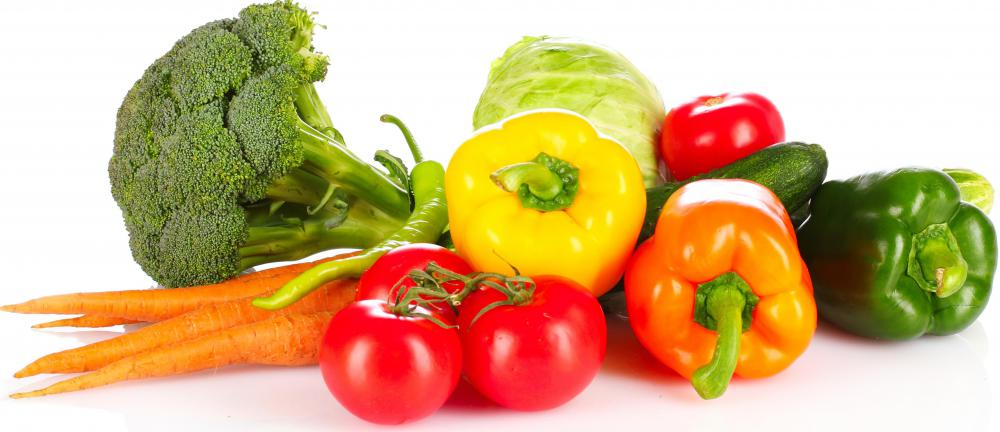 A selection of fresh vegetables, including broccoli, carrots, tomatoes, bell peppers, and others.