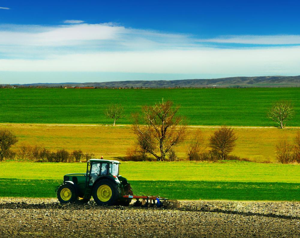 Farmers use tractors and other mechanical devices on modern farms.