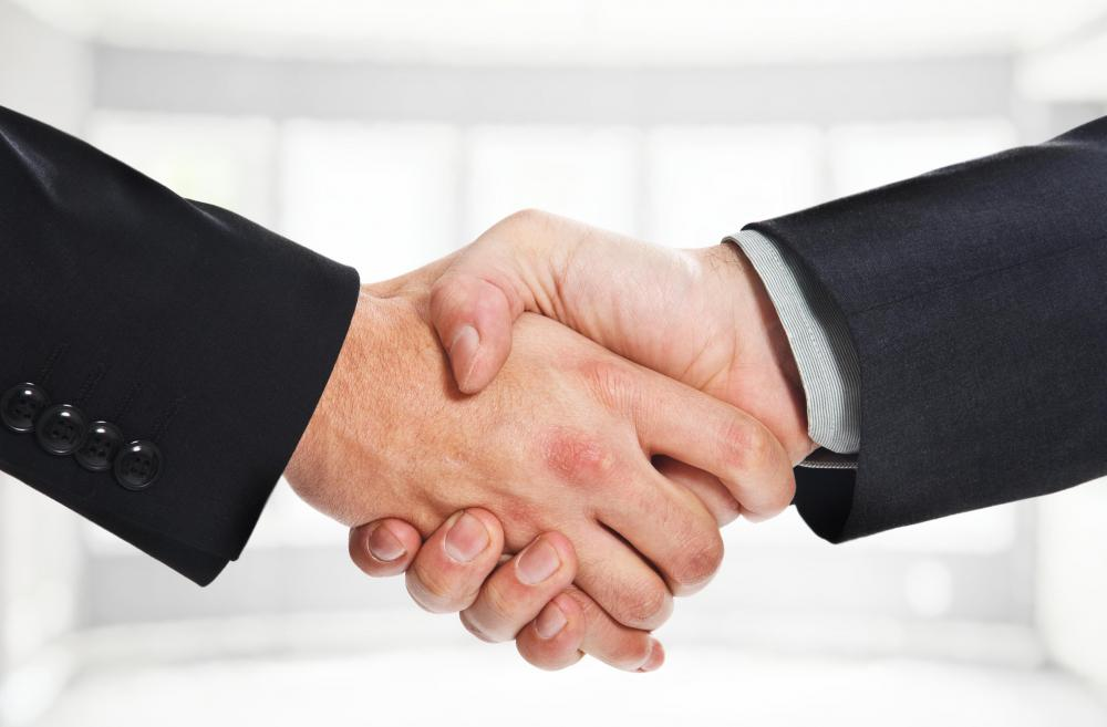 Proper business etiquette may include use of a handshake.