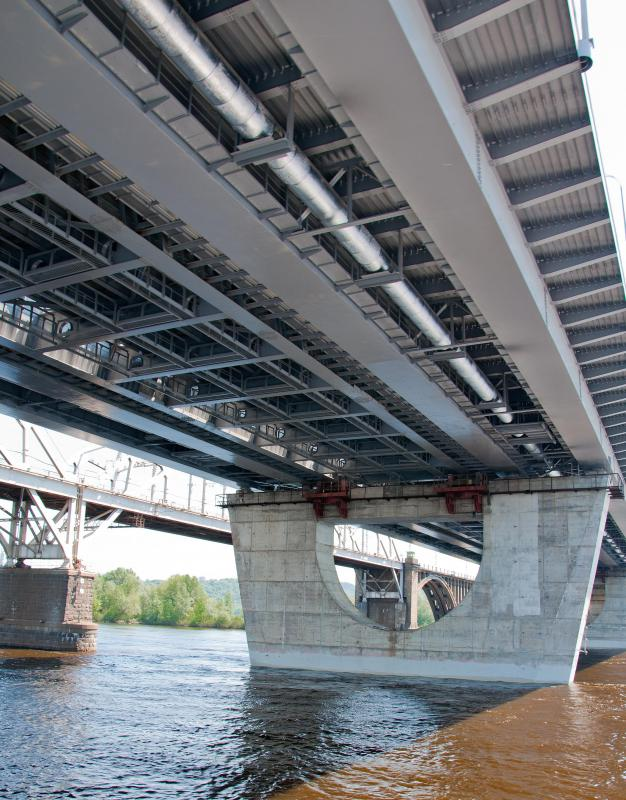 Thicker beams, such as the steel beams used in bridges, can have longer spans.