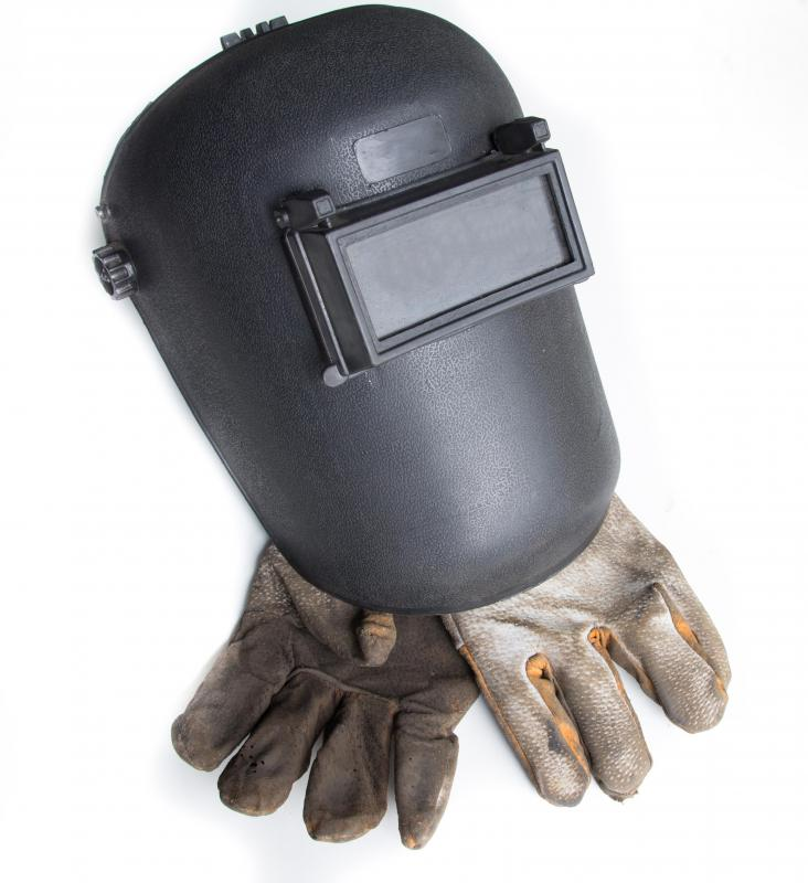 Welders wear special helmets and gloves for protection.