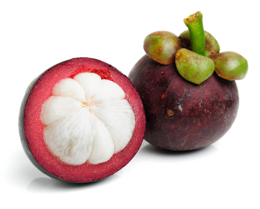 Whole and cut mangosteen.