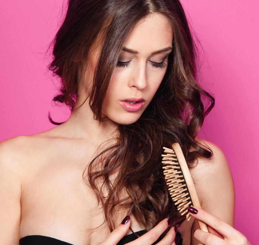 Liken wooden combs, wooden bristle brushes are also gentle on hair and prevent breaking.