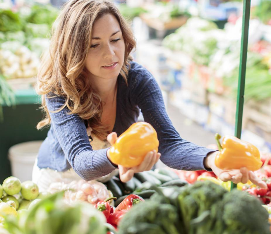 The shoppers at an organic market are customers as well as consumers.