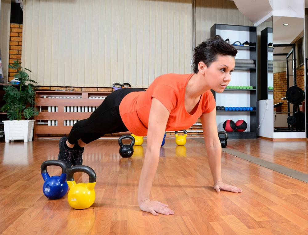 Though considered a body-weight exercise, push-ups can strengthen and tone the chest, arms and shoulders.