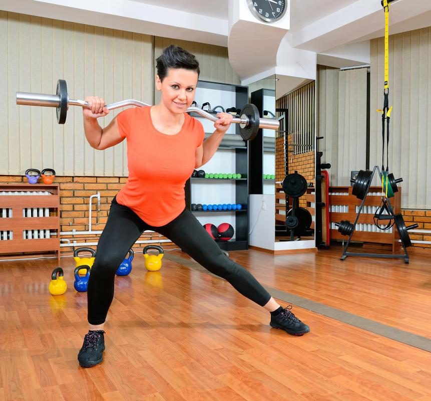 Side lunges, which can be performed with or without weights, can strengthen and tone the thighs, buttocks and hips.