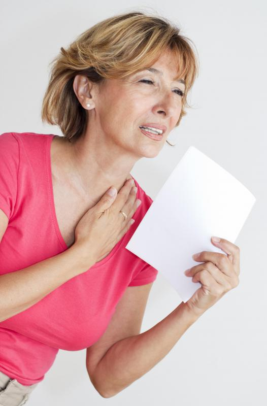 A reduction in estrogen leads to menopausal symptoms like hot flashes.