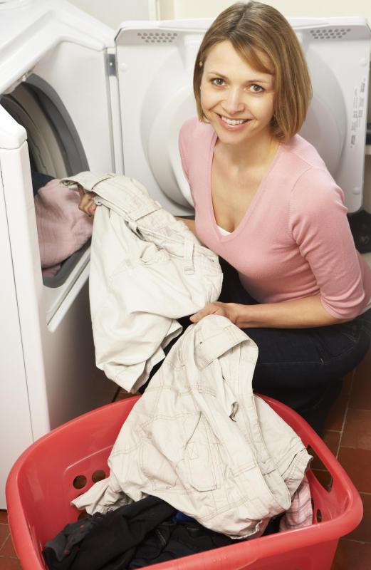 For tough-to-remove odors, apply a baking soda paste to the clothing and let it set for 24 hours before putting it in the laundry machine.