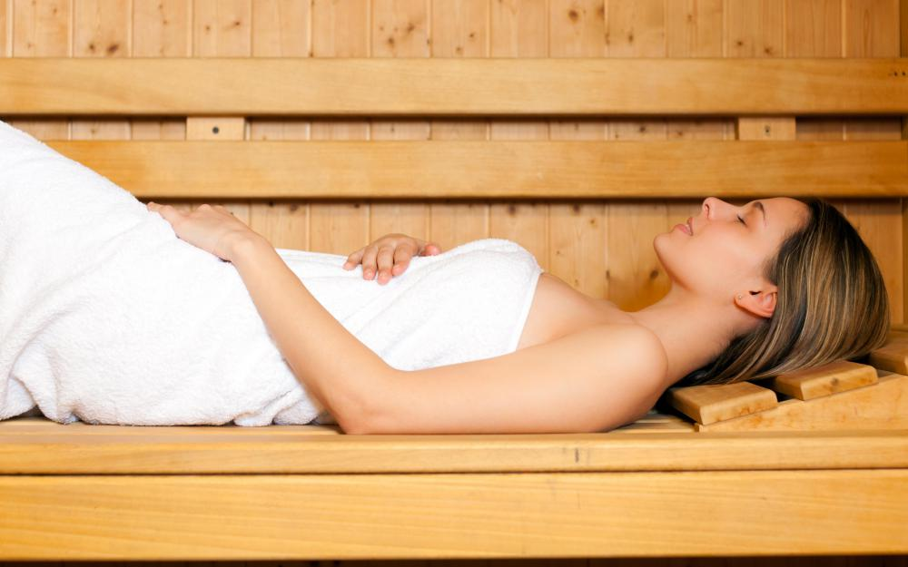 A sauna may make cellulite less noticeable because it reduces water retention.