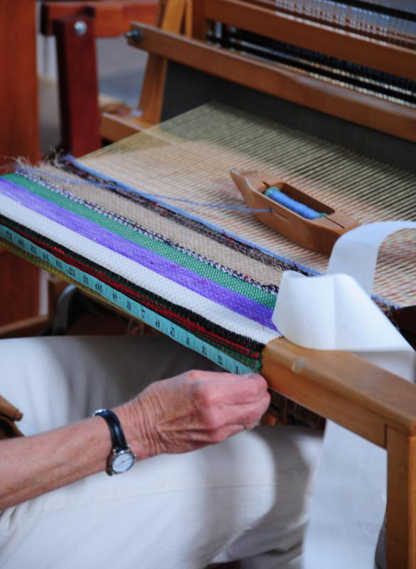 A floor loom is a large scale loom used to weave large projects like blankets and curtains.
