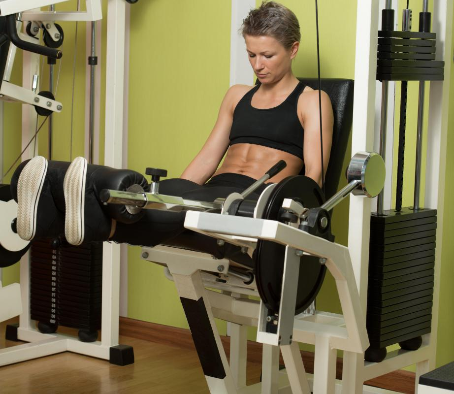 Leg extension machines allow users to exercise their quadriceps, or thigh muscles.