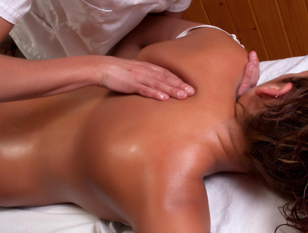 A Swedish massage therapist begins a session by warming the body and applying oil.