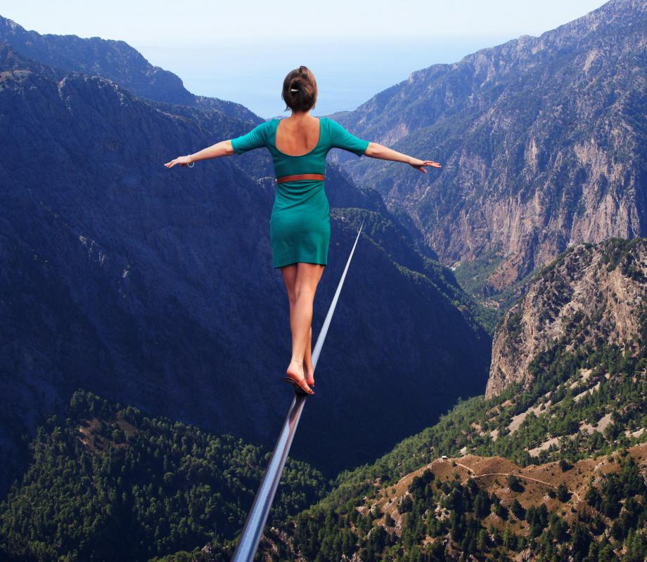 A tightrope walker is a person trained in acrobatics.