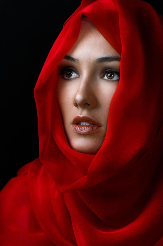 Woman wearing a silk scarf.