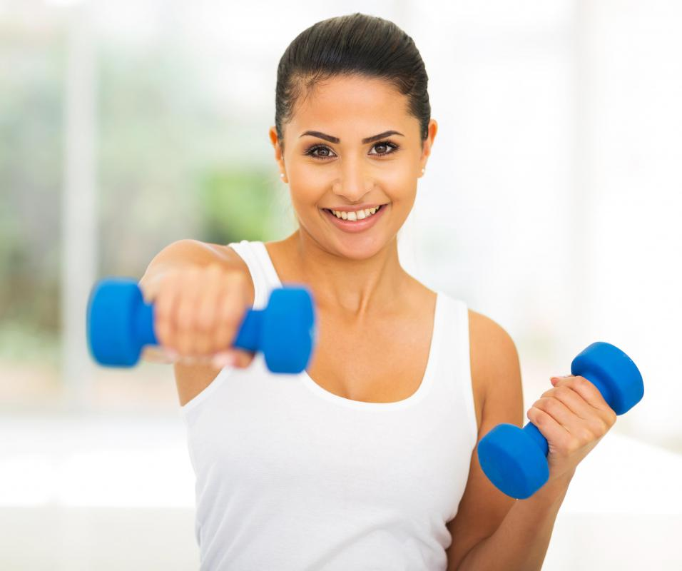 Hand weights can easily be used at home to improve muscle tone.
