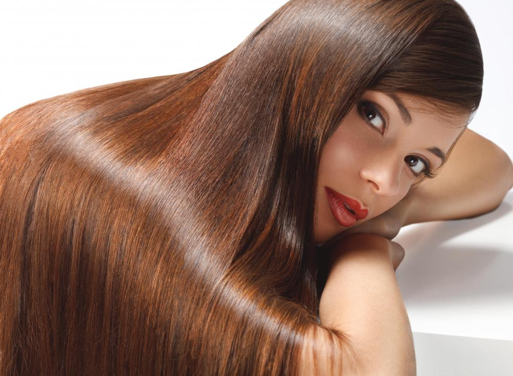 Women often get hair manicures for straighter, shinier hair.