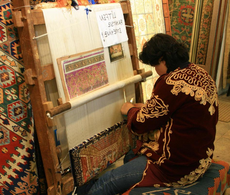 Making a tapestry using a non-powered loom is considered hand-weaving.