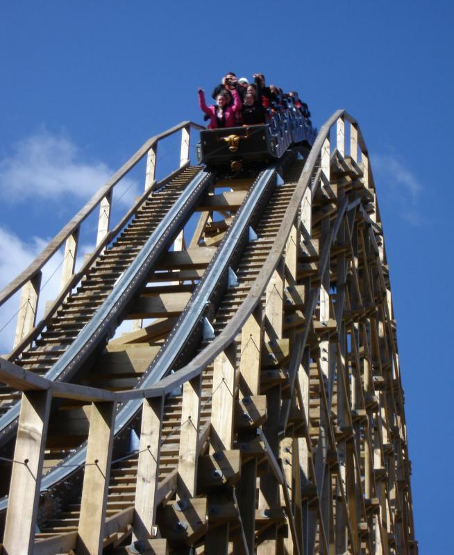 Roller coaster riders experience kinetic energy as they descend.
