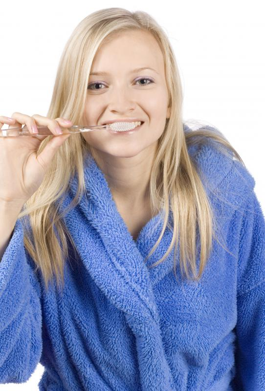 A single use toothbrush is used once to clean teeth, then discarded.
