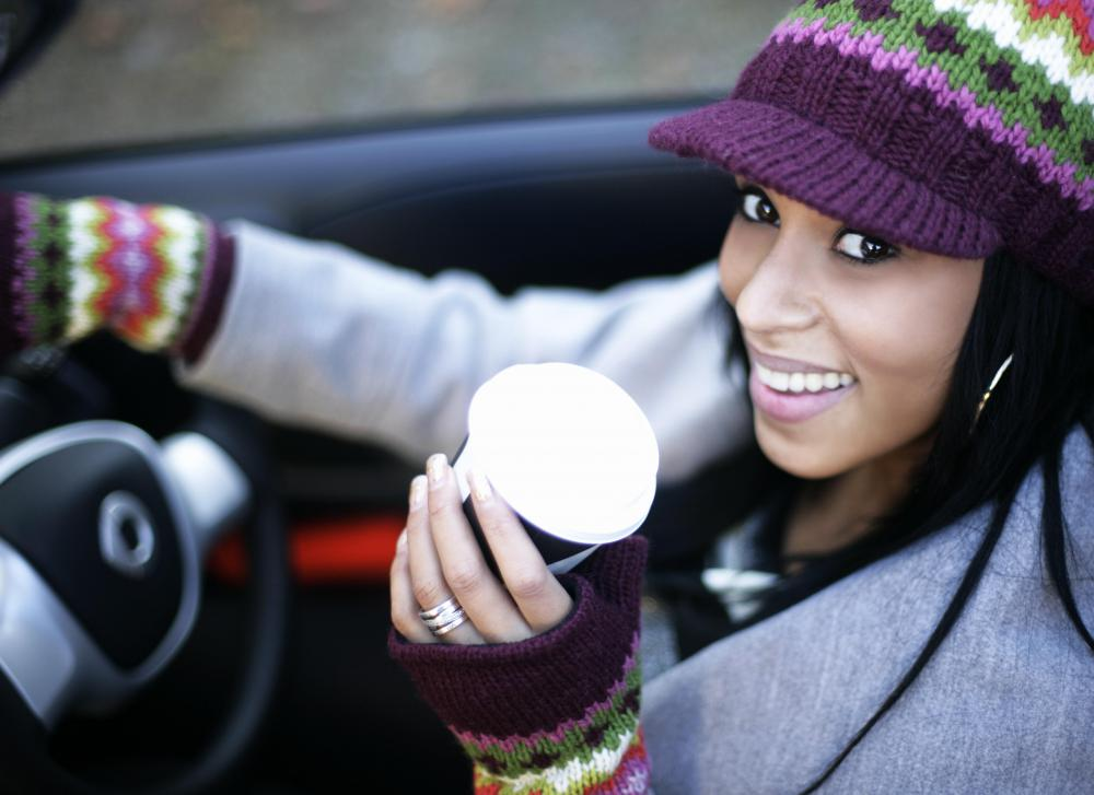 Many drivers multitask every day by drinking coffee while traveling.