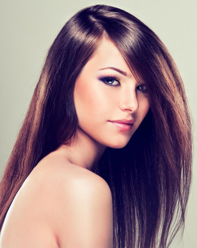 A hair manicure may be performed at a beauty parlor to repair dry, frizzy hair.