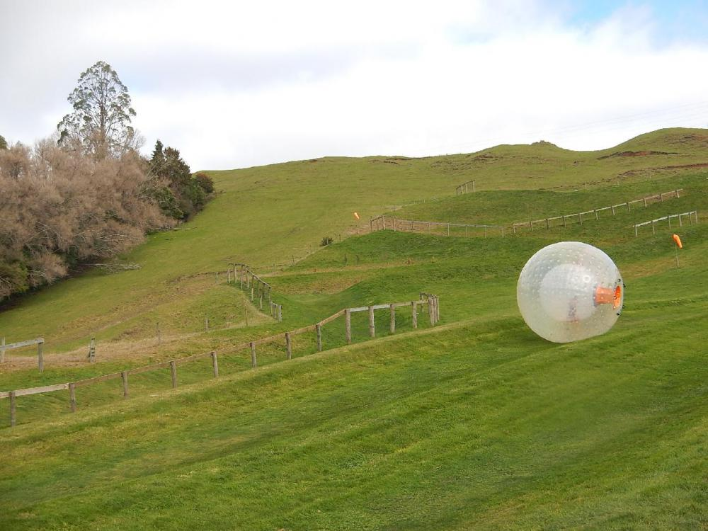 Zorbing involves rolling across water or down a slope in a giant inflatable ball.